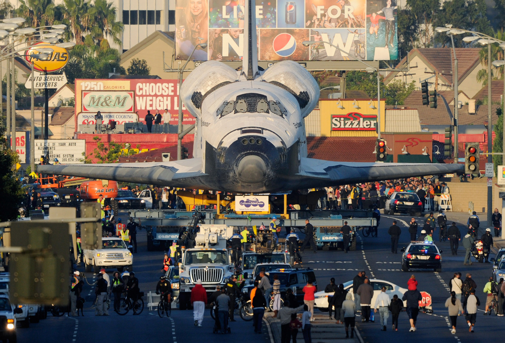Description of . The space shuttle Endeavour is transported to The Forum arena for a stopover and celebration on its way to the California Science Center from Los Angeles International Airport (LAX) on day two on October 12, 2012 in Inglewood, California. The space shuttle Endeavour is on 12-mile journey from Los Angeles International Airport to the California Science Center to go on permanent public display.  (Photo by Kevork Djansezian/Getty Images)