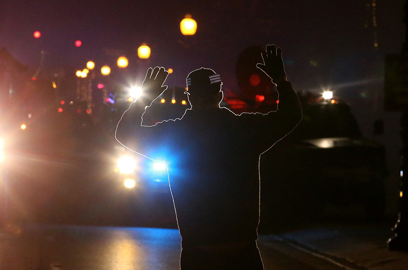 . A protestor stands in front of police vehicles with his hands up during a demonstration on November 24, 2014 in Ferguson, Missouri. A St. Louis County grand jury has decided to not indict Ferguson police Officer Darren Wilson in the shooting of Michael Brown that sparked riots in Ferguson, Missouri in August.  (Photo by Justin Sullivan/Getty Images)