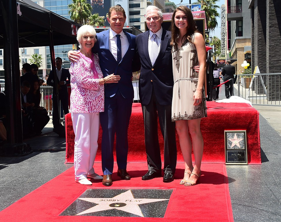 . Chef Bobby Flay poses with his parents and daughter Sophie during a Hollywood Walk of Fame ceremony on June 2, 2015, in Hollywood, California. Flay is the first television chef to be accorded the honor.        (FREDERIC J. BROWN/AFP/Getty Images)