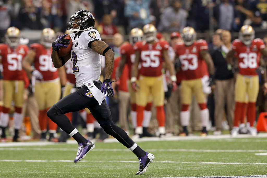 . Baltimore Ravens wide receiver Jacoby Jones (12) runs the second-half opening kickoff back for a touchdown against the San Francisco 49ers in the NFL Super Bowl XLVII football game, Sunday, Feb. 3, 2013, in New Orleans. (AP Photo/Patrick Semansky)