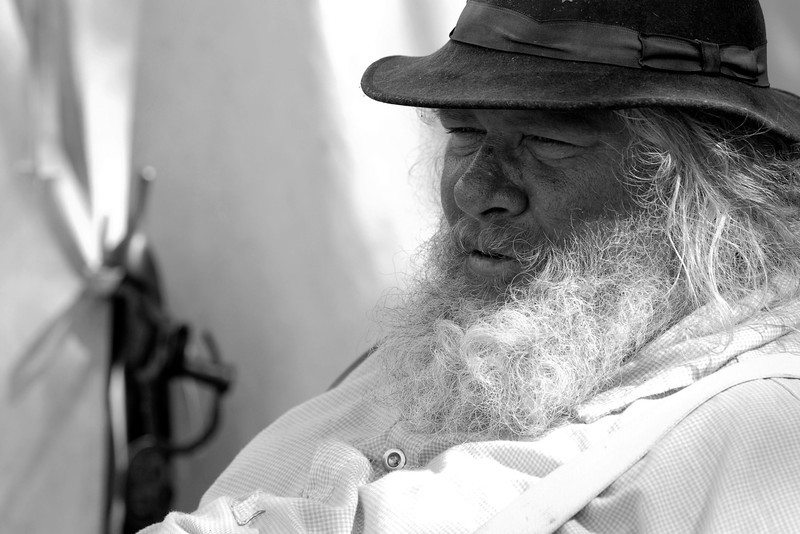 """Reenactor H.G. """"Garfield"""", portraying a provost, sits outside the camp to """"guard"""" it against invaders at Patriots Point, where a small group of Confederate reenactors set up camp, in Mt. Pleasant, South Carolina on Wednesday, April 13, 2011. ..The 150th Anniversary of the Firing on Ft. Sumter was commemorated with lectures, performances, demonstrations, and a living history throughout the area on James Island, Charleston, Mt. Pleasant, and Sullivan's Island during the week from April 8-14, 2011. Photo Copyright 2011 Jason Barnette"""