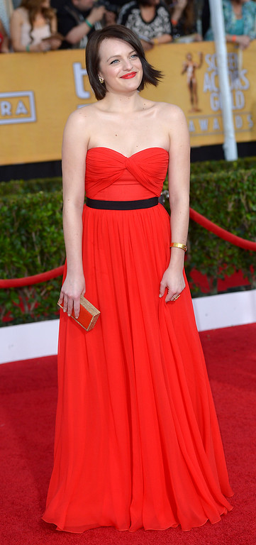 . Elisabeth Moss arrives at the 20th Annual Screen Actors Guild Awards  at the Shrine Auditorium in Los Angeles, California on Saturday January 18, 2014 (Photo by Michael Owen Baker / Los Angeles Daily News)