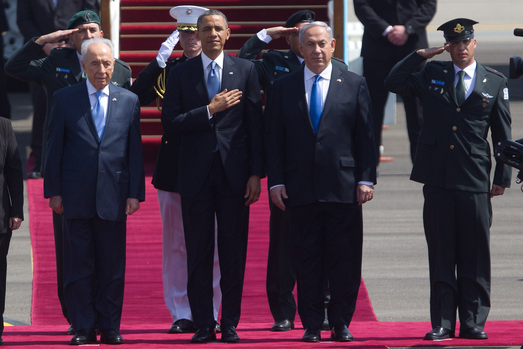 . US President Barack Obama (2nd , L) stands with Israeli President Shimon Peres (L) and Israeli Prime Minister Benjamin Netanyahu (3rd, L) for the American national anthem during an official welcoming ceremony on his arrival at Ben Gurion International Airport on March, 20, 2013 near Tel Aviv, Israel.(Photo by Uriel Sinai/Getty Images)