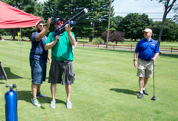 08/05/19 Wesley Bunnell | Staff John Scarritt from Thomaston Savings Bank takes his turn using a golf ball cannon during a closest to the target contest as Gil Bransford from CT Golf Event Planner helps and Jim Forker looks on. The Bristol Chamber of Commerce held their annual golf tournament on Monday at Tunxis Country Club in Farmington.