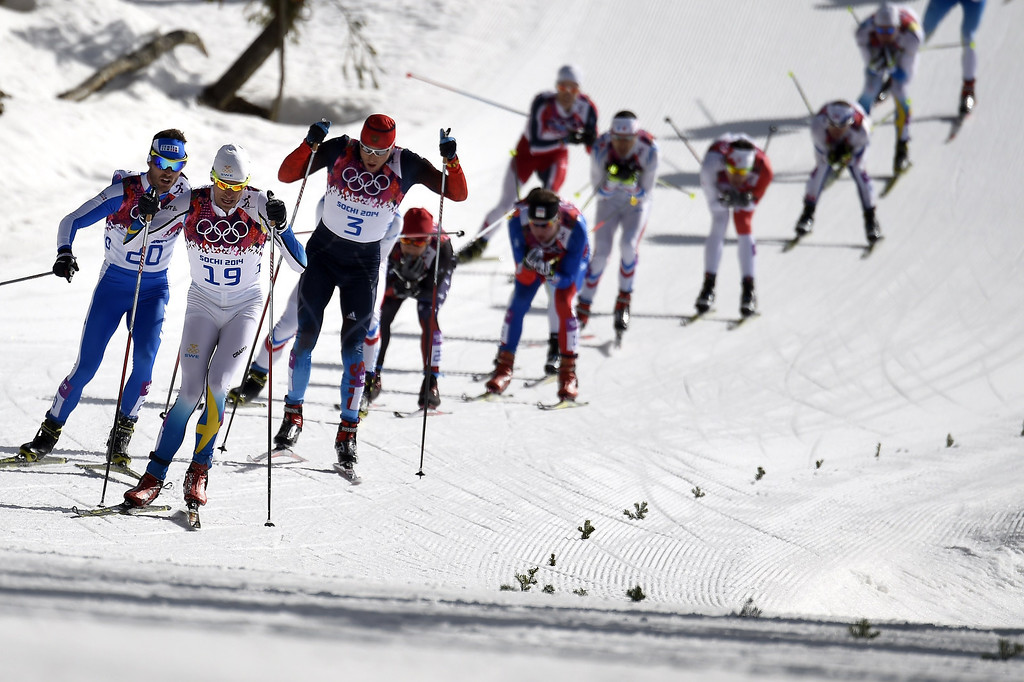 . (From L) Italy\'s Roland Clara, Sweden\'s Johan Olsson and Russia\'s Alexander Legkov compete during the Men\'s Cross-Country Skiing 50km Mass Start Free at the Laura Cross-Country Ski and Biathlon Center during the Sochi Winter Olympics on February 23, 2014, in Rosa Khutor, near Sochi. ODD ANDERSEN/AFP/Getty Images