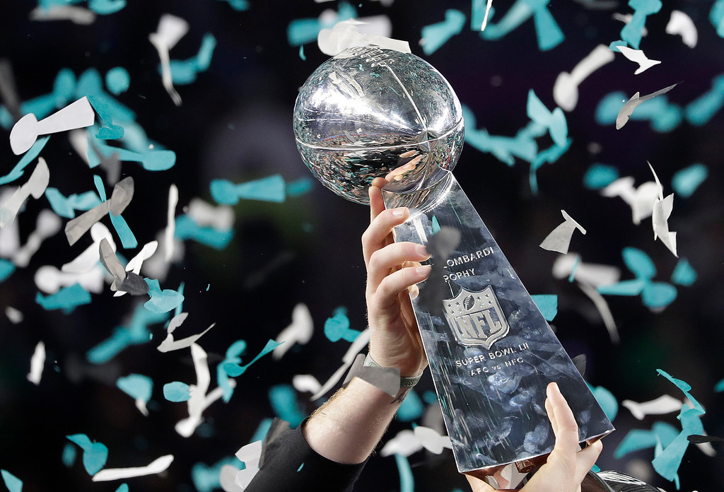 . Philadelphia Eagles\' Carson Wentz holds up the Vince Lombardi Trophy after the NFL Super Bowl 52 football game against the New England Patriots, Sunday, Feb. 4, 2018, in Minneapolis. The Eagles won 41-33. (AP Photo/Matt Slocum)