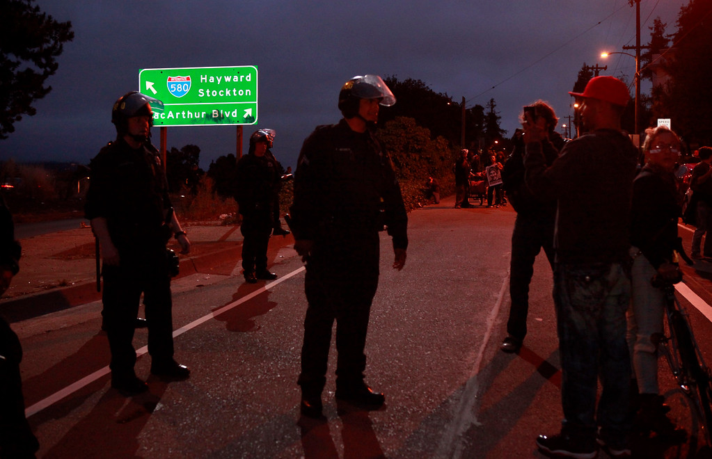 . Oakland Police block Trayvon Martin protesters from entering the 580 freeway on MacArthur Blvd. during the third day of unrest over the acquittal of George Zimmerman on Monday evening, July 15, 2013 in Oakland, Calif. (Karl Mondon/Bay Area News Group)