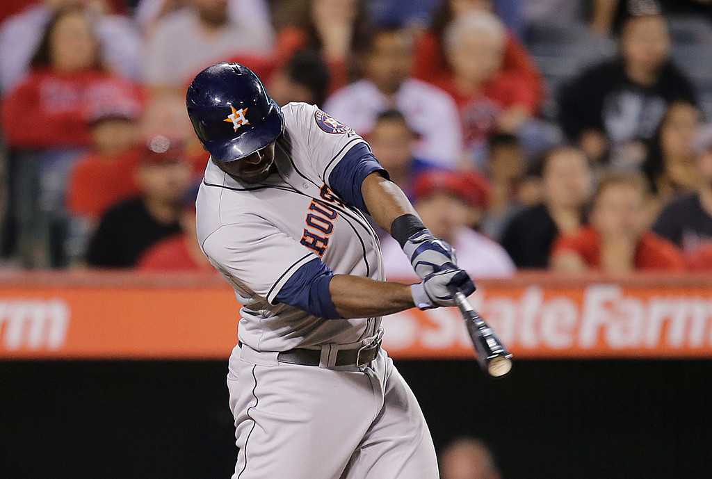 . Houston Astros\' Chris Carter hits a three-run home run against the Los Angeles Angels during the ninth inning of a baseball game on Friday, Aug. 16, 2013, in Anaheim, Calif. (AP Photo/Jae C. Hong)