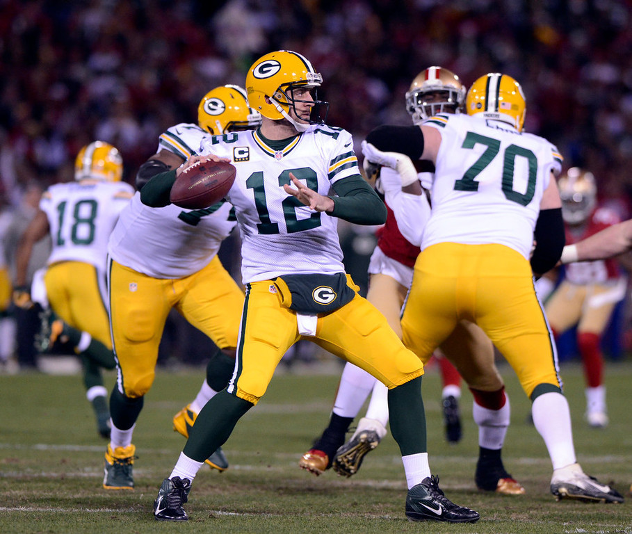 . Green Bay Packers quarterback Aaron Rodgers drops to pass against the San Francisco 49ers during the first quarter in the NFC Divisional Playoff on Saturday, January 12, 2013, at Candlestick Park in San Francisco, California. (Jose Carlos Fajardo/San Jose Mercury News)