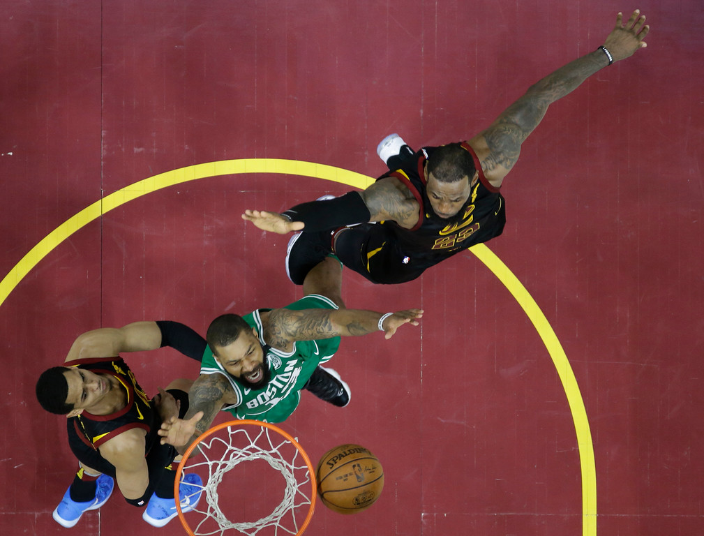 . Boston Celtics\' Marcus Morris (13) goes for a rebound with Cleveland Cavaliers\' Jordan Clarkson (8), left, and LeBron James in the first half of Game 3 of the NBA basketball Eastern Conference finals, Saturday, May 19, 2018, in Cleveland. (AP Photo/Tony Dejak)