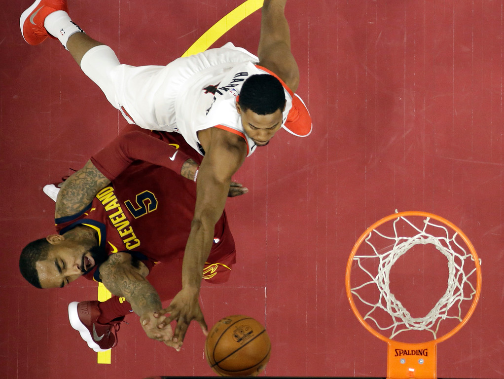 . Cleveland Cavaliers\' JR Smith (5) drives to the basket against Portland Trail Blazers\' Maurice Harkless (4) in the second half of an NBA basketball game, Tuesday, Jan. 2, 2018, in Cleveland. The Cavaliers won 127-110. (AP Photo/Tony Dejak)