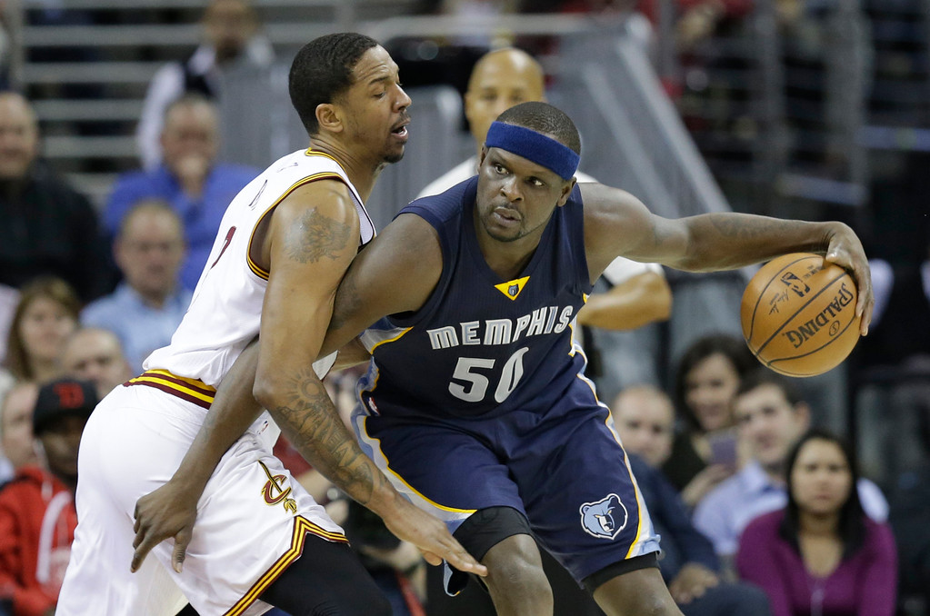 . Memphis Grizzlies\' Zach Randolph (50) tries to get past Cleveland Cavaliers\' Channing Frye (8) in the second half of an NBA basketball game Tuesday, Dec. 13, 2016, in Cleveland. (AP Photo/Tony Dejak)