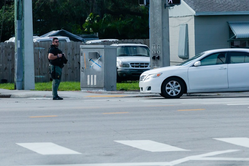 A Palm Beach County Sheriff stops traffic along Kirk Road as President Donald J. Trump's motorcade travels to Trump International Golf Club on Summit Blvd. in West Palm Beach on Saturday, January 04, 2020. [JOSEPH FORZANO/palmbeachpost.com]