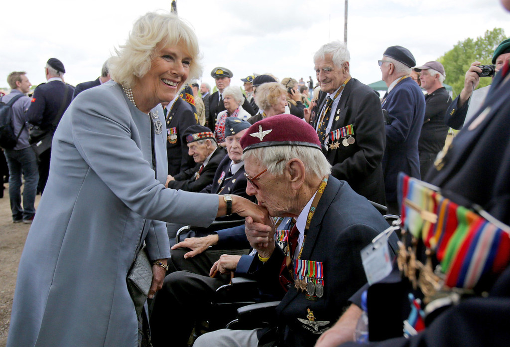 . British Normandy Veteran Raymond Shuck, who was a paratrooper on D-Day kisses the hand of Camilla, Duchess of Cornwall as she meets veterans near Pegasus Bridge (Also known as the Bénouville Bridge - The taking of the Bridge was an important strategic victory) during D-Day Commemorations on June 5, 2014 in Ranville, near Caen in Normandy, France.  (Photo by Matt Cardy/Getty Images)