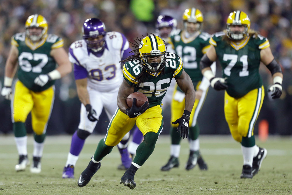 . Green Bay Packers running back DuJuan Harris (26) runs during the first half of an NFL wild card playoff football game against the Minnesota Vikings Saturday, Jan. 5, 2013, in Green Bay, Wis. (AP Photo/Jeffrey Phelps)