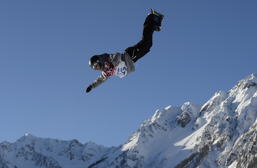 . Japan\'s Yuki Kadono competes in the Men\'s Snowboard Slopestyle first heat qualification at the Rosa Khutor Extreme Park during the Sochi Winter Olympics on February 6, 2014. AFP PHOTO / FRANCK FIFE/AFP/Getty Images
