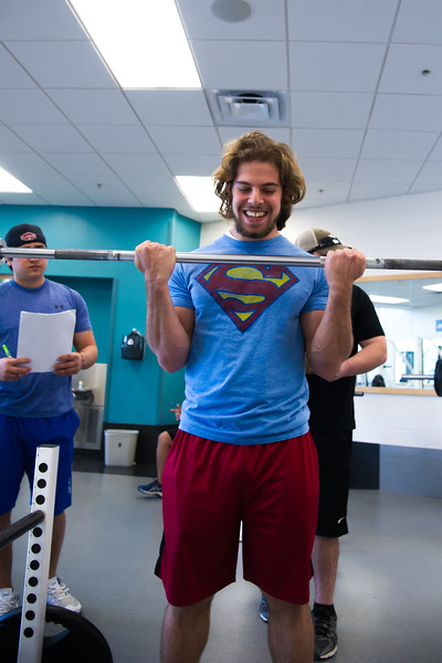 Eyad Elqutub doing a max curl assessment in Exercise Physiology Lab