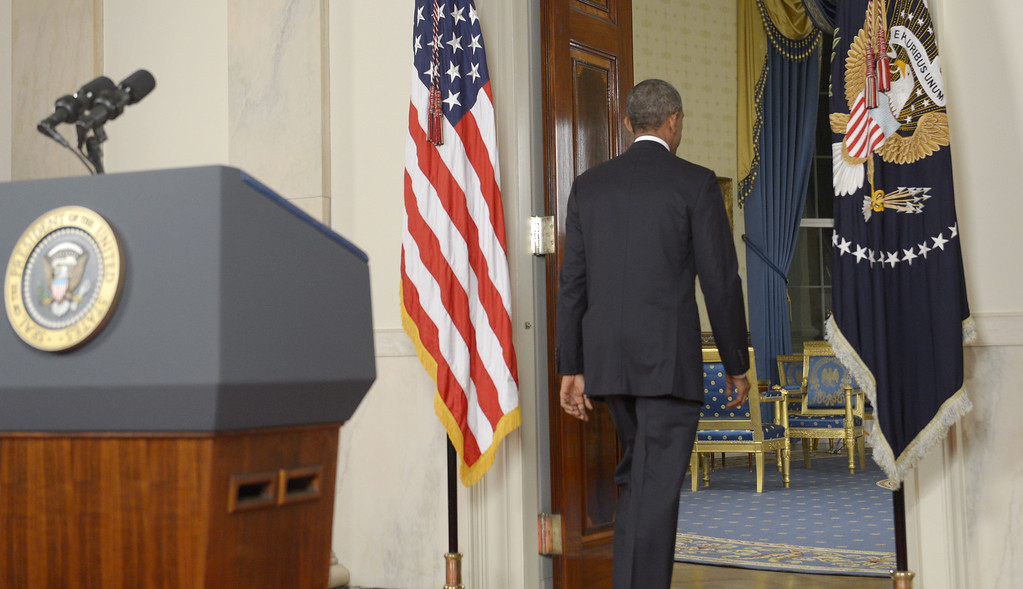 """. US President Barack Obama departs after delivering a prime time address from the Cross Hall of the White House on September 10, 2014 in Washington, DC.  Vowing to target the Islamic State with air strikes \""""wherever they exist\"""", Obama pledged to lead a broad coalition to fight IS and work with \""""partner forces\"""" on the ground in Syria and Iraq.  AFP PHOTO/POOL/Saul LOEBSAUL LOEB/AFP/Getty Images"""