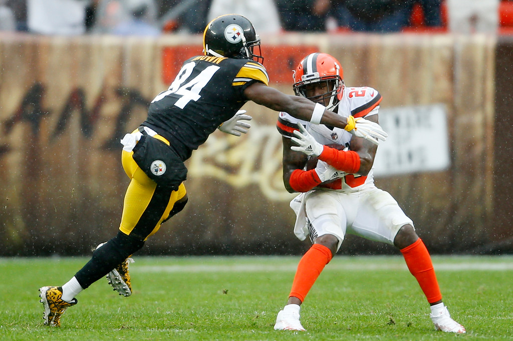 . Cleveland Browns defensive back Damarious Randall (23) is tackled by Pittsburgh Steelers wide receiver Antonio Brown (84) after intercepting the ball during the first half of an NFL football game, Sunday, Sept. 9, 2018, in Cleveland. (AP Photo/Ron Schwane)