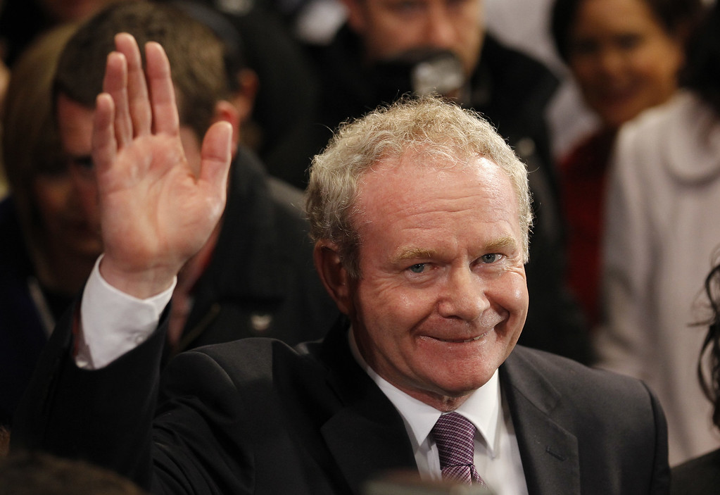 . FILE - This is a Friday, Oct. 28, 2011  file photo of Sinn Fein\'s Martin McGuinness as he waves to the media while waiting to hear the results in the first count in the  presidential election  at Dublin Castle, Ireland.  McGuinness, an IRA and Sinn Fein leader who became a minister of peacetime Northern Ireland, has died, according to UK media Tuesday, March 21, 2017.  (AP Photo/Peter Morrison/File)