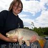 Misha Herring with a fine common carp at Trinity Waters, Woodland Lake, 280510. © 2010 Brian Gay