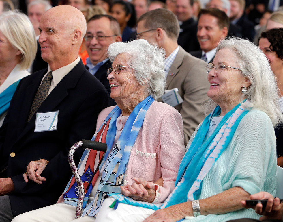 . Family members of former U.S. Sen. John Glenn, left to right, son David Glenn, wife Annie Glenn, and daughter Lyn Glenn react to Glenn\'s speech during a celebration for the renaming of Port Columbus International Airport to John Glenn Columbus International Airport Tuesday, June 28, 2016, in Columbus, Ohio. Senate Bill 159, which changes the name of the airport, goes into effect in September. (AP Photo/Jay LaPrete)
