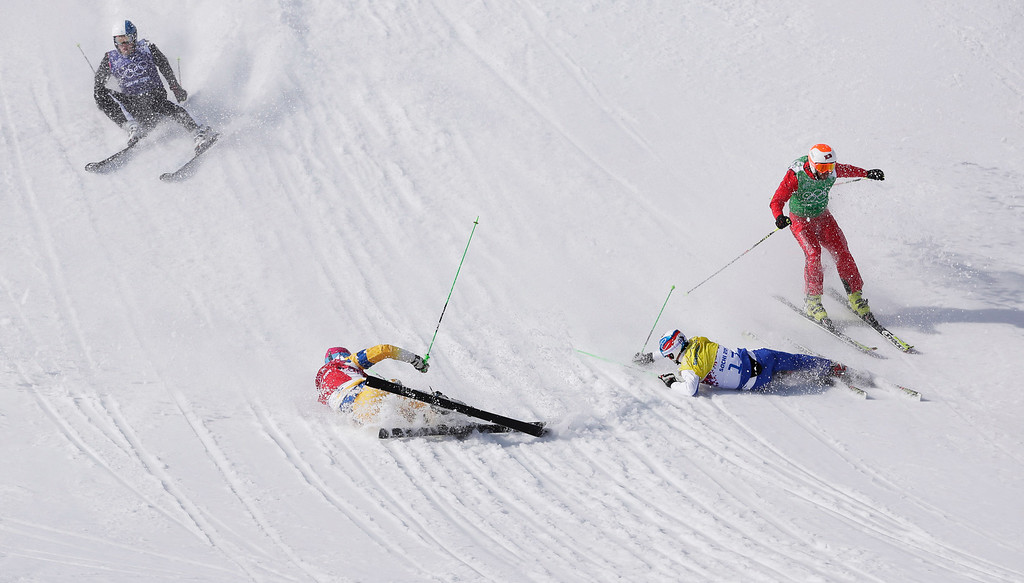 . Switzerland\'s Armin Niederer, right, skis past, from left,  Finland\'s Jouni Pellinen, Victor Oehling Norberg of Sweden, and Russia\'s Igor Korotkov to win the first men\'s ski cross quarterfinal at the Rosa Khutor Extreme Park, at the 2014 Winter Olympics, Thursday, Feb. 20, 2014, in Krasnaya Polyana, Russia. (AP Photo/Andy Wong)