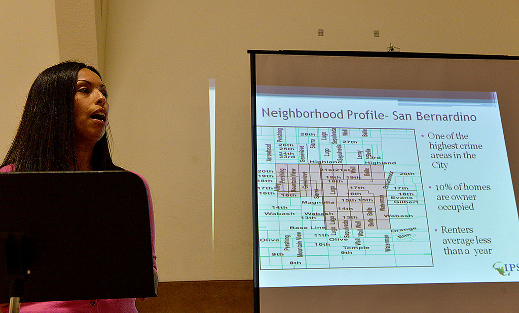 . Sandra Espasdas, from the Institute for Public Strategies, speaks to residents in a high-crime area of San Bernardino about the aim to reduce crime and violence in the area during a meeting Thursday April 3, 2014 in the gym at The Church of Nazarene. Representatives of the IPS Byrne Project, an initiative by the Institute for Public Strategies, will discuss ways that residents can help drive the effort to reclaim the neighborhood. (Staff photo by Rick Sforza/The Sun)