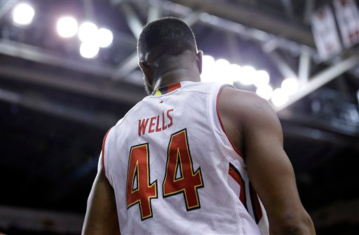. Maryland guard/forward Dez Wells stands on the court in the second half of an NCAA college basketball game against Michigan, Saturday, Feb. 28, 2015, in College Park, Md. (AP Photo/Patrick Semansky)