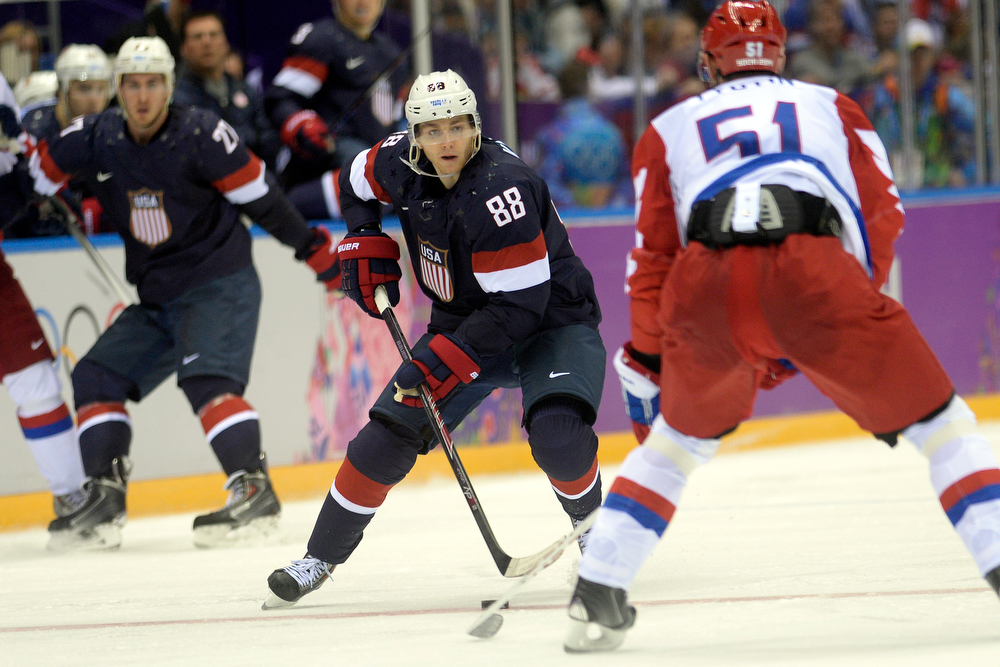 . Fyodor Tyutin (51) of the Russia defends Patrick Kane (88) of the U.S.A. during  the third period of the U.S.A.\'s shootout-win at Bolshoy arena. Sochi 2014 Winter Olympics on Saturday, February 15, 2014. (Photo by AAron Ontiveroz/The Denver Post)