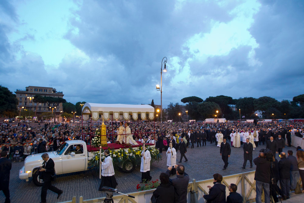 . Pope Francis leads the Corpus Domini procession from St. John at the Lateran Basilica to St. Mary Major Basilica to mark the feast of the Body and Blood of Christ, in Rome, Thursday, May 30, 2013. The event is dedicated to the mystery of the Eucharist and concludes the cycle of feasts following Easter. Pope Francis celebrated the evening Mass at St. John in Lateran Basilica then traveled a short distance in a procession to St. Mary Major Basilica. (AP Photo/Andrew Medichini)