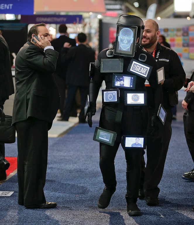 ". A character called ""Tablet Man\"" walks through an exhibit hall showcasing a variety of tablets powered with Accessory Power products at the Consumer Electronics Show, Thursday, Jan. 10, 2013, in Las Vegas. (AP Photo/Julie Jacobson)"