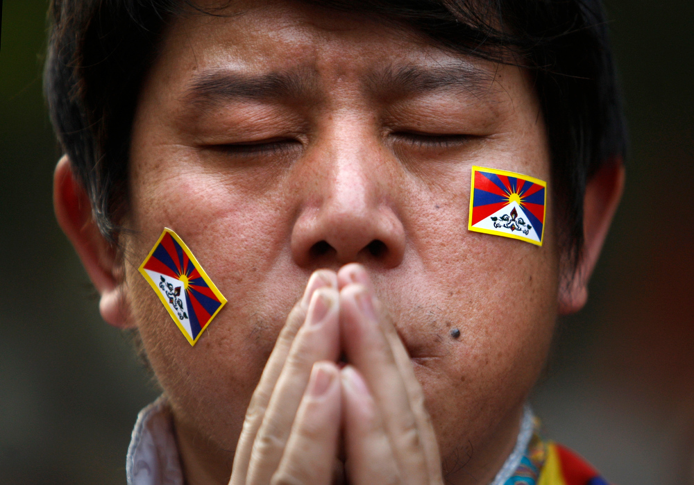 Description of . An exiled Tibetan Buddhist man prays during a rally to mark World Human Rights Day in New Delhi, India, Monday, Dec. 10, 2012. At least 86 people have set themselves on fire since 2009. Tibetans also mark Dec. 10 as the Nobel Peace Prize Day, the day the Dalai Lama received the Nobel peace prize in 1989. (AP Photo/Tsering Topgyal)
