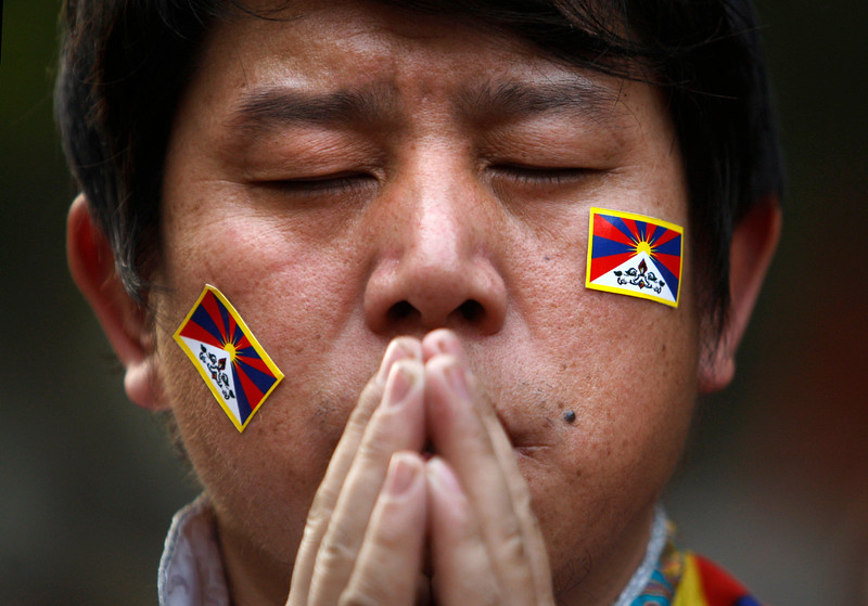 . An exiled Tibetan Buddhist man prays during a rally to mark World Human Rights Day in New Delhi, India, Monday, Dec. 10, 2012. At least 86 people have set themselves on fire since 2009. Tibetans also mark Dec. 10 as the Nobel Peace Prize Day, the day the Dalai Lama received the Nobel peace prize in 1989. (AP Photo/Tsering Topgyal)