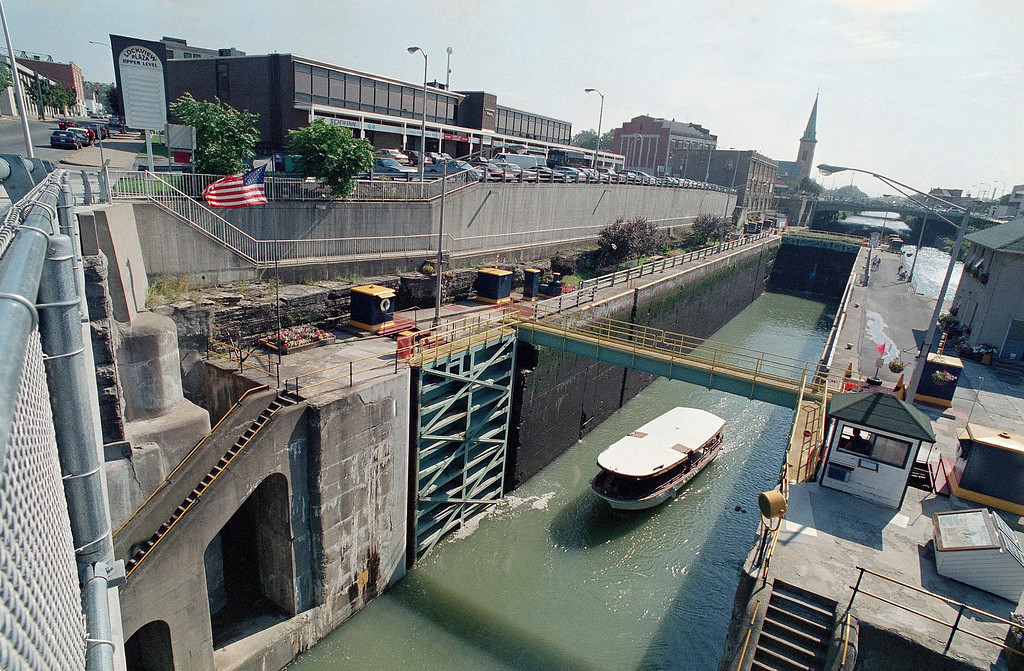 . A boat moves through the double lock system on the Erie Canal in downtown at Lockport, N.Y., Aug. 24, 1993.  The canal builders originally built two five-lock flights to lower eastbound and raise westbound boats simultaneously through the Niagara escarpment. (AP Photo/Bill Sikes)