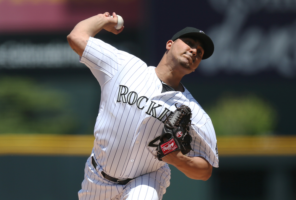 . Colorado Rockies starting pitcher Jhoulys Chacin works against the Atlanta Braves in the first inning of a baseball game in Denver on Thursday, June 12, 2014. (AP Photo/David Zalubowski)