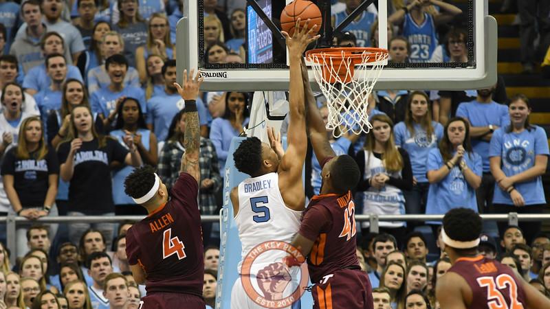 North Carolina Tar Heels forward Tony Bradley (5) scores an easy basket between Virginia Tech Hokies guard/forward Ty Outlaw (42) and guard Seth Allen (4). (Michael Shroyer/ TheKeyPlay.com)