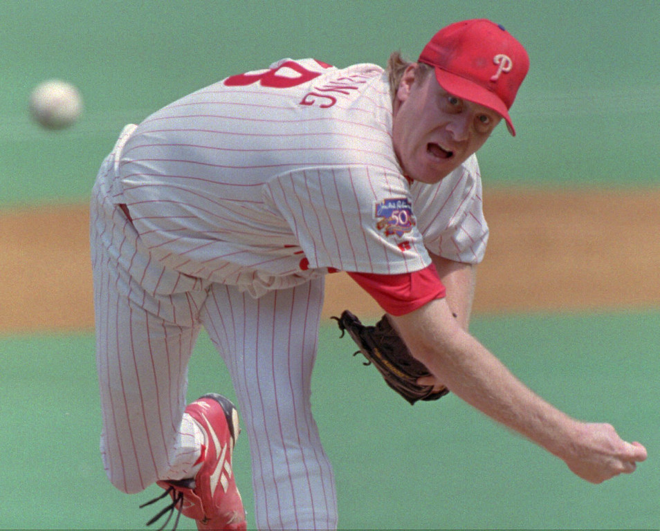 . CURT SCHILLING -- Philadelphia Phillies pitcher Curt Schilling grimaces as he throws to the New York Yankees during the second inning on Sept. 1, 1997 in Philadelphia. Schilling struck out 16 in eight innings of work.(AP Photo/Rusty Kennedy)