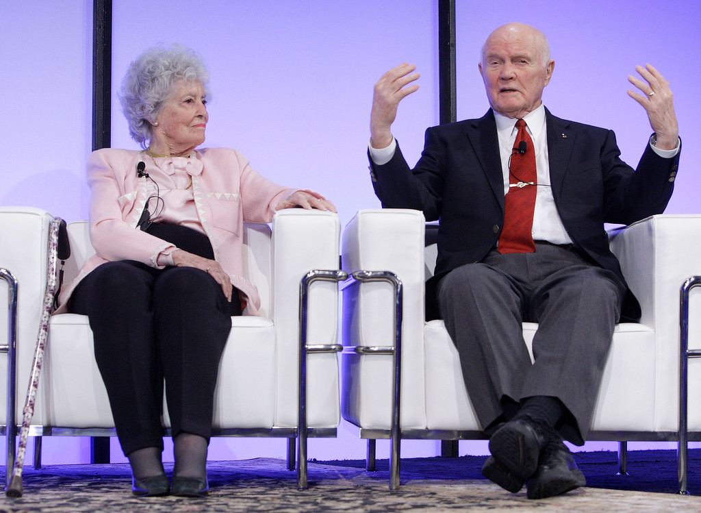 . Sen. John Glenn, right, with his wife Annie, answers questions during a celebration dinner honoring his legacy on the 50th anniversary of his historic flight aboard Friendship 7 Monday, Feb. 20, 2012, in Columbus, Ohio. Glenn was the first American to orbit Earth, piloting Friendship 7 around it three times in 1962, and also became the oldest person in space, at age 77, by orbiting Earth with six astronauts aboard shuttle Discovery in 1998. (AP Photo/Jay LaPrete)
