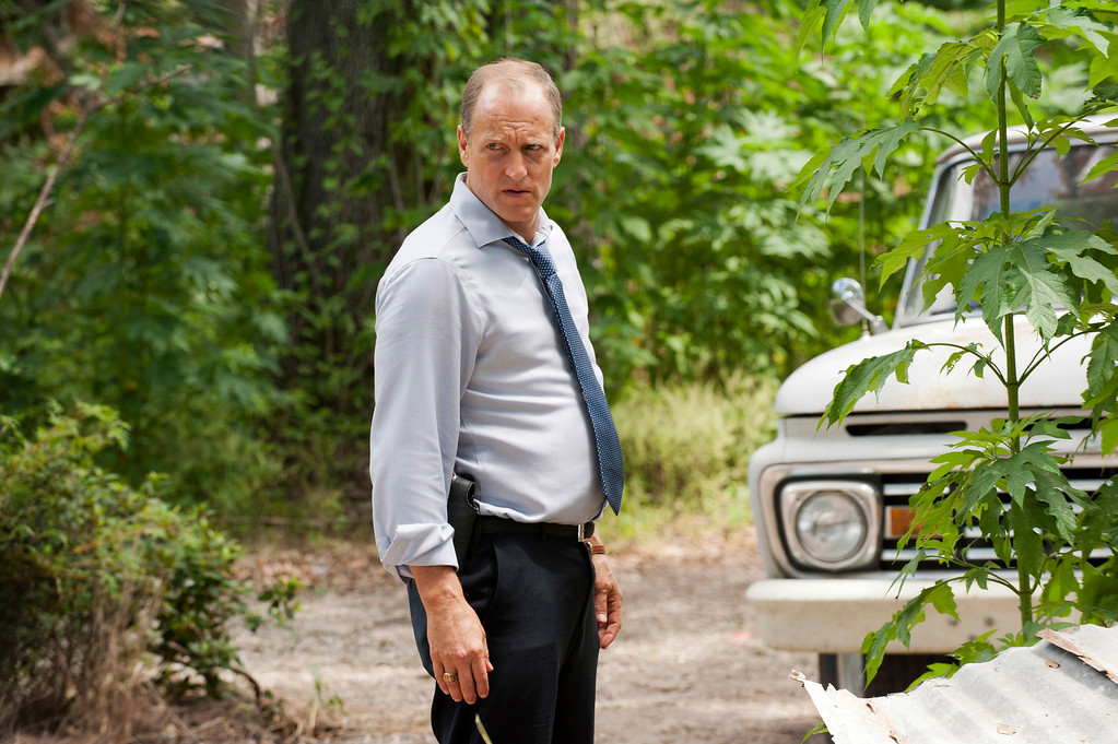""". This photo released by HBO shows Woody Harrelson as Martin Hart in a scene from \""""True Detective.\"""" Harrelson was nominated for a Golden Globe for best actor in a TV movie or mini-series for his role on Thursday, Dec. 11, 2014. The 72nd annual Golden Globe awards will air on NBC on Sunday, Jan. 11. (AP Photo/HBO, Lacey Terrell)"""