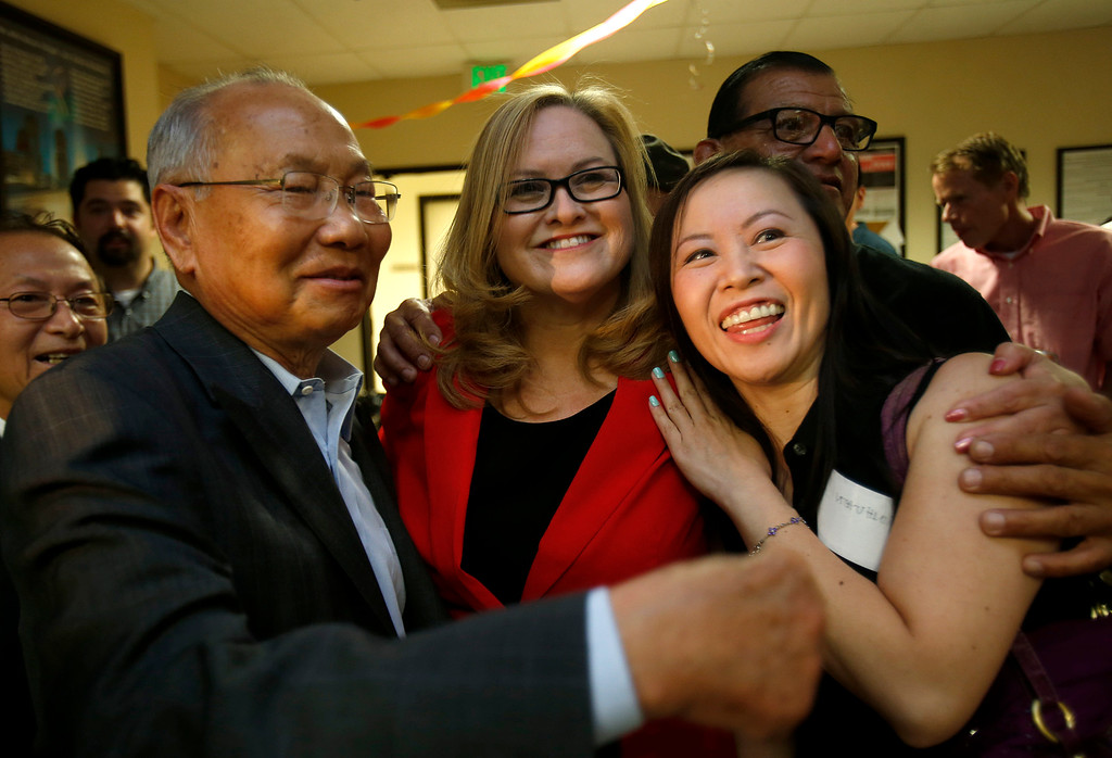 . Cindy Chavez, center, gets a hug and photograph with supporter Minhuyen Tran, right, and Bing Khac Nguyen, left, on election night for the Santa Clara County District 2 supervisor at the South Bay AFL-CIO Labor Council headquarters in San Jose, Calif. on Tuesday, July 30, 2013.  (Nhat V. Meyer/Bay Area News Group)