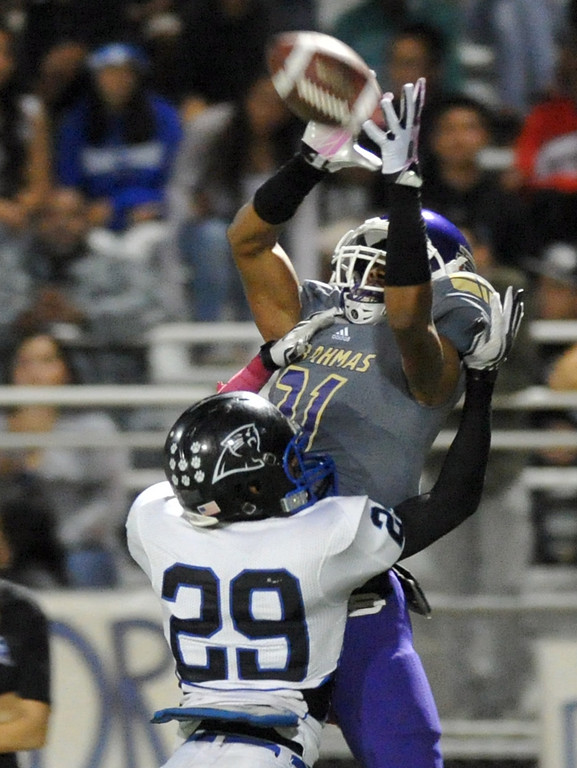 . Diamond Bar receiver Cordell Broadus (#21) pulls down a pass under pressure from Diamond Ranch\'s Justin Berry (#29) in their Hacienda League football game at Diamond Bar High School on Friday October 18, 2013. (San Gabriel Valley Tribune/Staff Photo by Keith Durflinger)