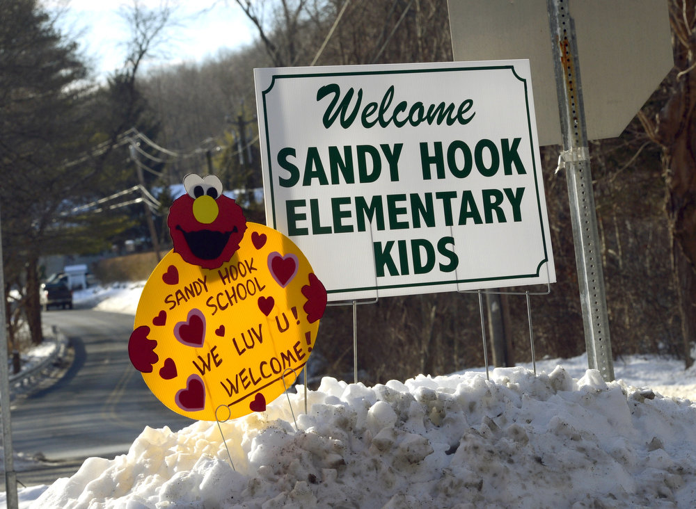 Description of . A sign welcoming children from Sandy Hook Elementary school sits on the road in Monroe, Connecticut on January 3, 2013.  Students at the elementary school where a gunman massacred 26 children and teachers last month were returning Thursday to classes at an alternative campus described by police as