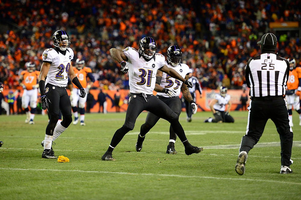 Description of . Baltimore Ravens strong safety Bernard Pollard (31) protests a penalty call in the third quarter. The Denver Broncos vs Baltimore Ravens AFC Divisional playoff game at Sports Authority Field Saturday January 12, 2013. (Photo by AAron  Ontiveroz,/The Denver Post)