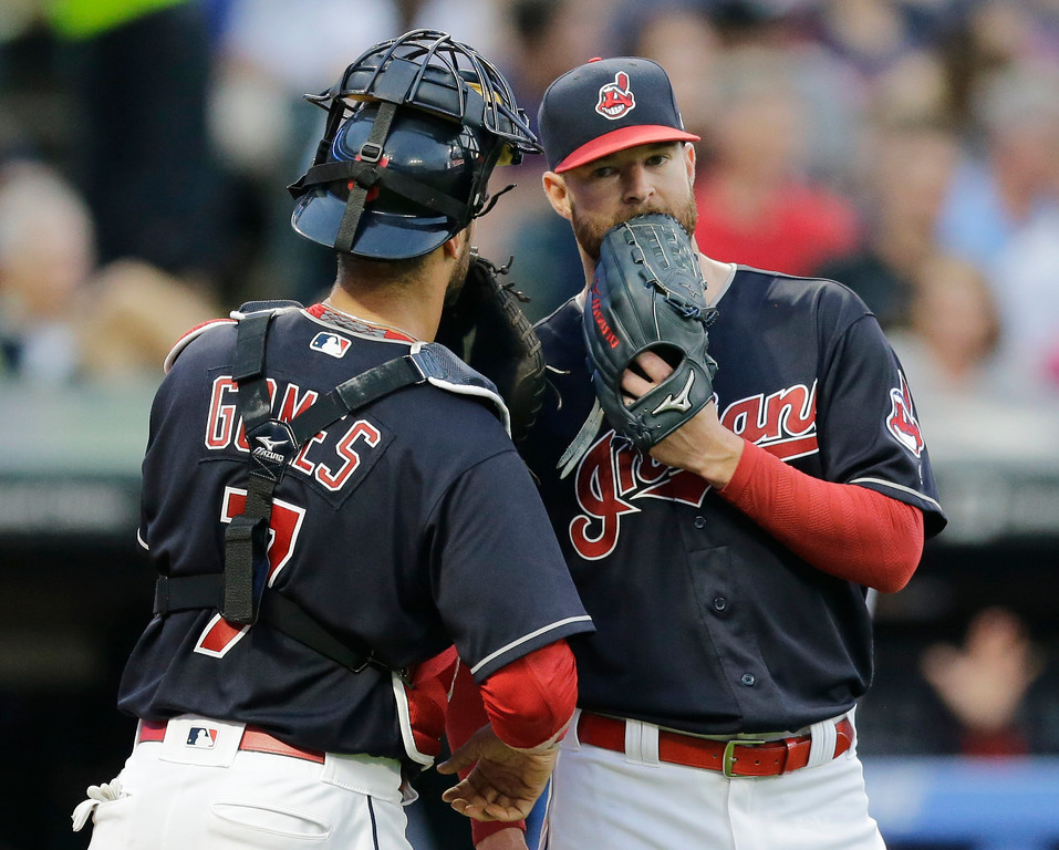 . Cleveland Indians starting pitcher Corey Kluber, right, talks with catcher Yan Gomes during the second inning of the team\'s baseball game against the Los Angeles Dodgers, Wednesday, June 14, 2017, in Cleveland. (AP Photo/Tony Dejak)