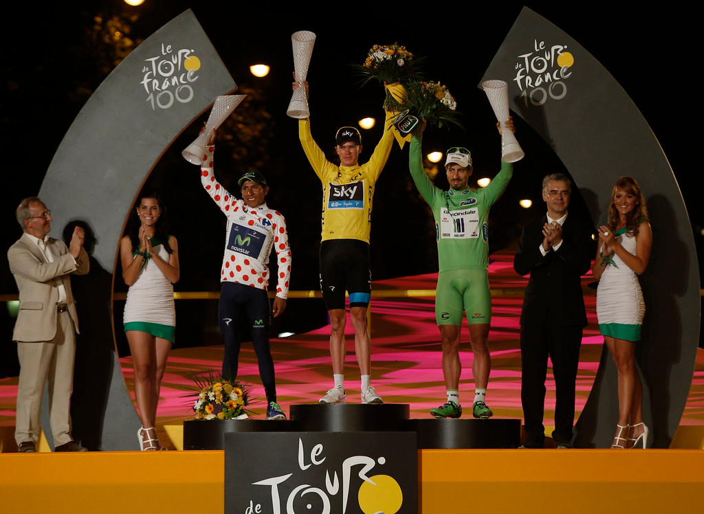 . 2013 Tour de France cycling race winner Christopher Froome of Britain, wearing the overall leader\'s yellow jersey, Nairo Alexander Quintana of Colombia, wearing the best climber\'s dotted jersey, and Peter Sagan of Slovakia, wearing the best sprinter\'s green jersey, celebrate on the podium of the 100th edition of the Tour de France cycling in Paris, France, Sunday July 21 2013.  (AP Photo/Laurent Cipriani)