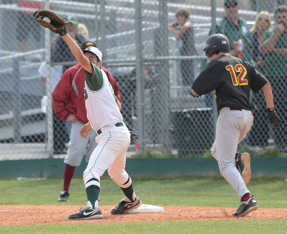 . South\'s Kurtis Brajevich (14) makes the play at first against Estancia in a first-round CIF SS Division IV baseball game Friday in Torrance. South won 7-2. 20130517 Photo by Steve McCrank / Staff Photographer