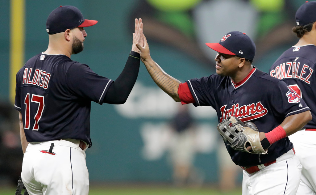 . Cleveland Indians\' Yonder Alonso, left, celebrates with Cleveland Indians\' Jose Ramirez after the Indians defeated the Minnesota Twins 8-1 in a baseball game, Tuesday, Aug. 28, 2018, in Cleveland. (AP Photo/Tony Dejak)