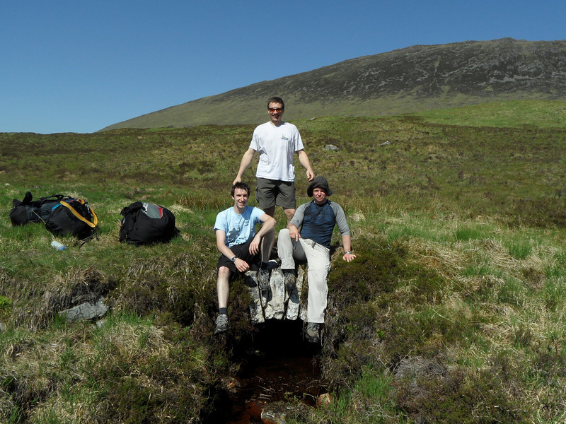 A long, hot walk up, but thankfully a stream with  a packhorse bridge in the middle of nowhere. L to R  Alex, Jules and Steve.