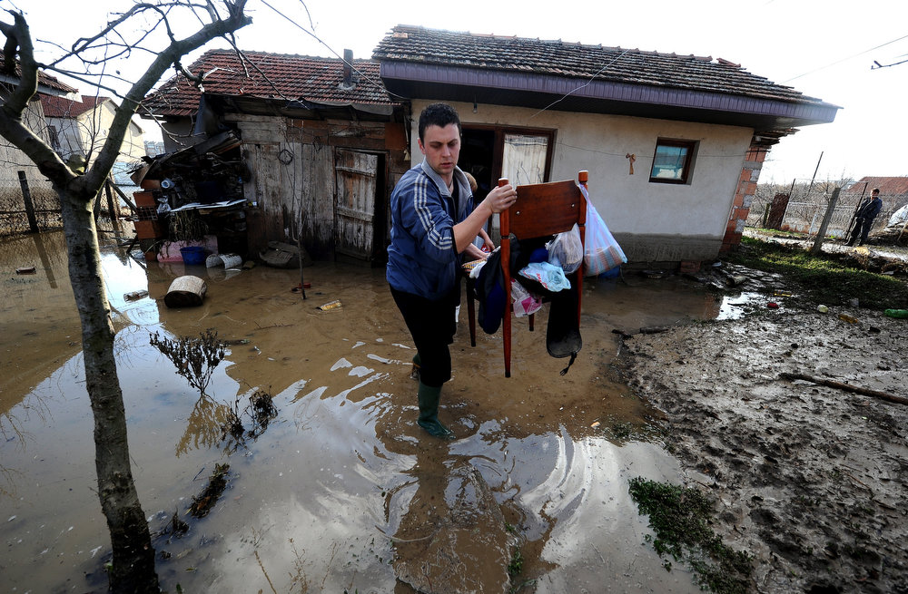 Description of . A man carries belongings out of his flooded house in the town of Sveti Nikole, some 60 kilometers northeast from Skopje on February 26, 2013. Torrential rains in the last three days caused dozens of floods, affecting many villages and towns, and damaging crops. ROBERT ATANASOVSKI/AFP/Getty Images